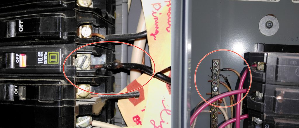 Singed wiring is a definite warning sign that an electrician should evaluate the electrical system further.